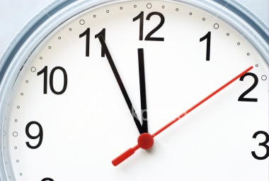 stock-photo-5860307-clock-showing-5-minutes-to-12